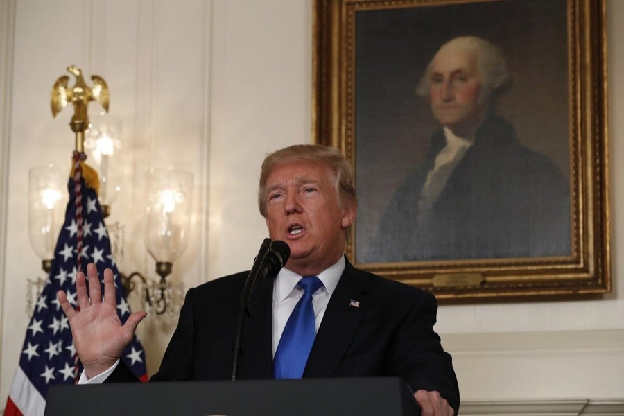 US President Donald Trump speaks about the Iran nuclear deal in the Diplomatic Room of the White House in Washington, US, Oct 13, 2017. Reuters