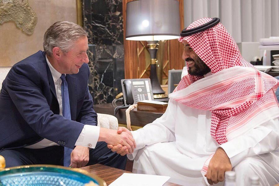 Saudi Crown Prince Mohammed bin Salman shakes hands with NEOM's Chief Executive Officer Klaus Kleinfeld on Tuesday. -Reuters Photo