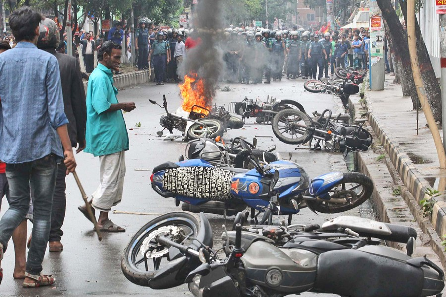 A number of motorcycles were torched during a clash between two groups of ruling party Awami League in front of a community centre at Azimpur in the capital on Thursday. The skirmish took place around 10:30am.— Focus Bangla
