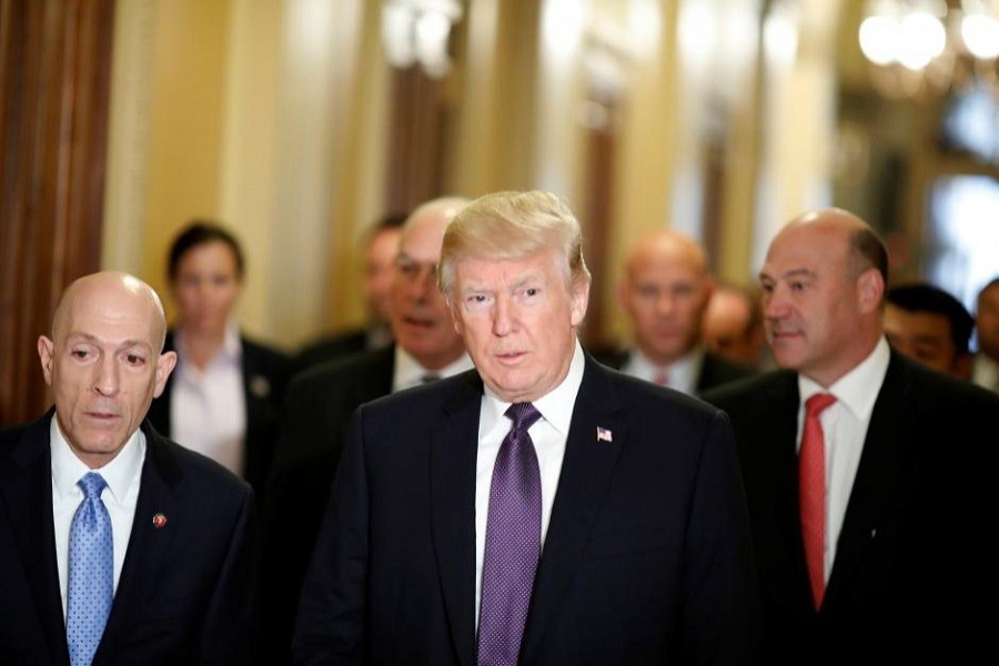 """US President Donald Trump arrives with Director of the National Economic Council Gary Cohn at the US Capitol to meet with House Republicans ahead of their vote on the """"Tax Cuts and Jobs Act"""" in Washington, US, November 16, 2017. Reuters"""