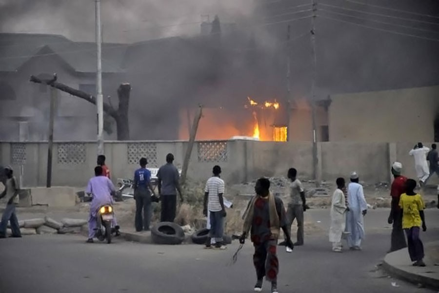 People watch as smoke rises from the police headquarters in Nigeria's northern city of Kano after a bomb attack on January 20, 2012. ( Reuters photo used for representational purpose)