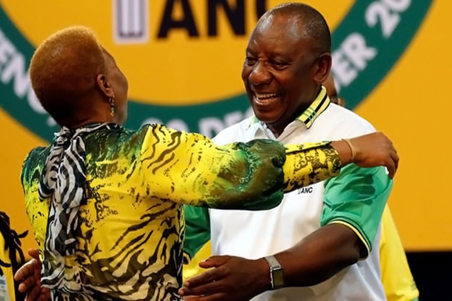 Cyril Ramaphosa greets an ANC member during the party conference in Johannesburg on Monday. (Reuters Photo)