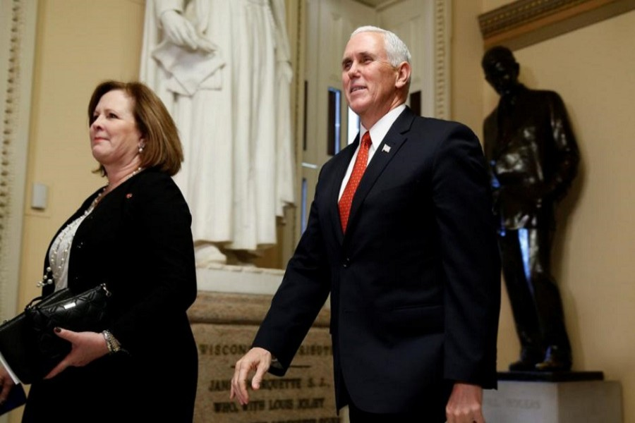 US Vice President Mike Pence walks outside the House of Representatives at the Capitol in Washington, December 19, 2017. Reuters