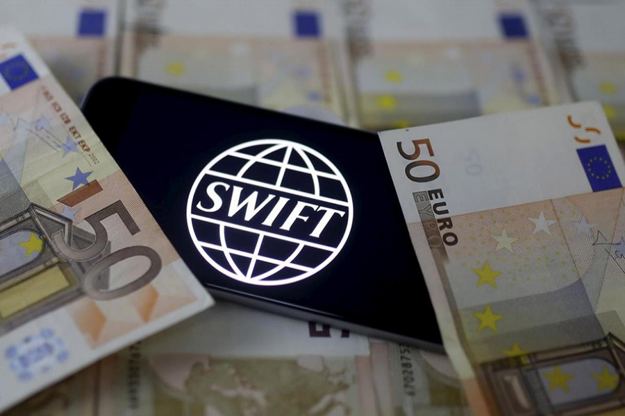 Swift code bank logo is displayed on an iPhone 6s on top of Euro banknotes in this picture illustration. - Reuters