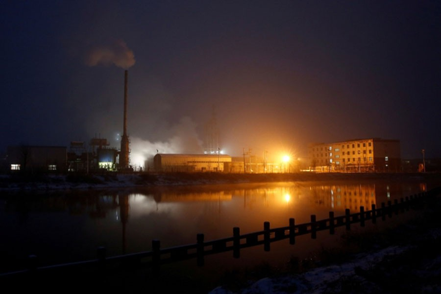 Steam and smoke rise from a factory in the Guantao Chemical Industry Park in the early morning near the villages of East Luzhuang and Nansitou, Hebei province, February 22, 2017. Reuters /File Photo