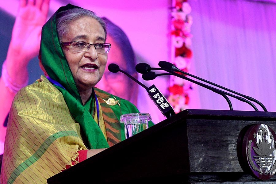 Prime Minister Sheikh Hasina speaking at a special extended meeting of Awami League at Ganabhaban in Dhaka marking the party's founding day on Saturday. -Focus Bangla Photo