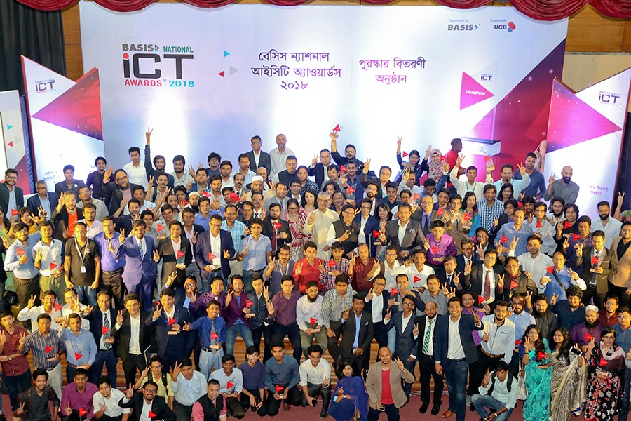 Posts, Telecommunications and ICT Minister Mustafa Jabbar with the recipients of BASIS National ICT Awards 2018 at a function in the city on Thursday — FE photo