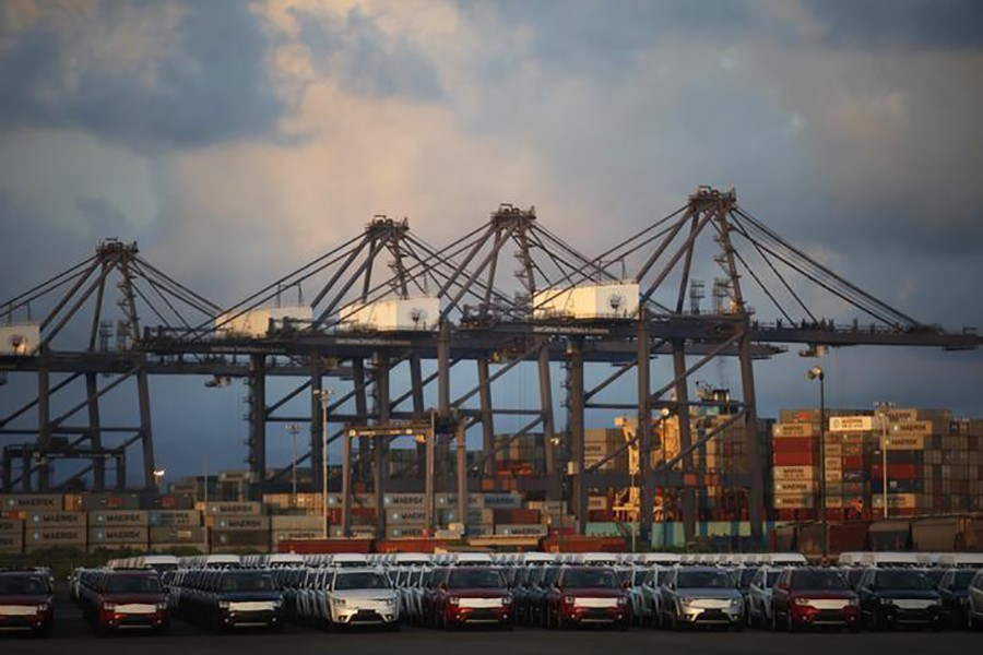 Cars and containers are seen in the port of Lazaro Cardenas, Mexico on November 20, 2013 — Reuters/Files
