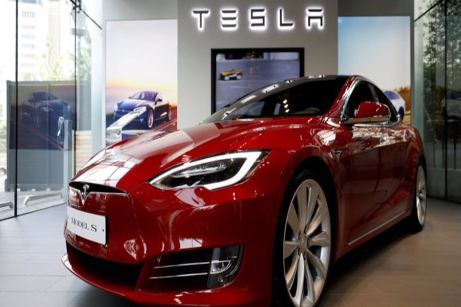Tesla electric car catches fire after hitting a tow truck in Moscow