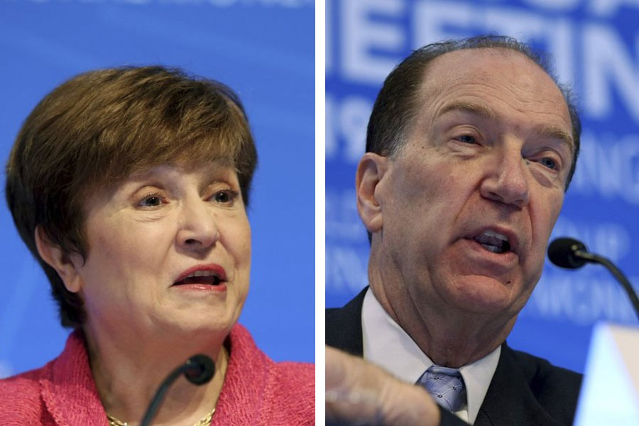 International Monetary Fund (IMF) Managing Director Kristalina Georgieva and World Bank President David Malpass speaking during a news conference during the World Bank/IMF Annual Meetings in Washington on Thursday. -AP Photos