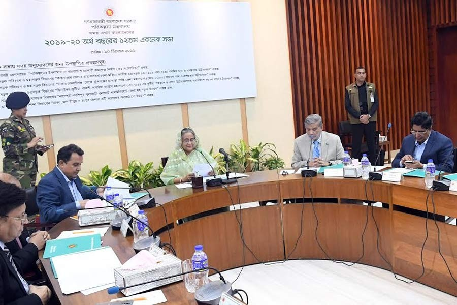 ECNEC Chairperson and Prime Minister Sheikh Hasina presiding over the 12th ECNEC meeting of the current fiscal year at the NEC Conference Room in the city's Sher-e-Bangla Nagar area on Tuesday. -BSS Photo