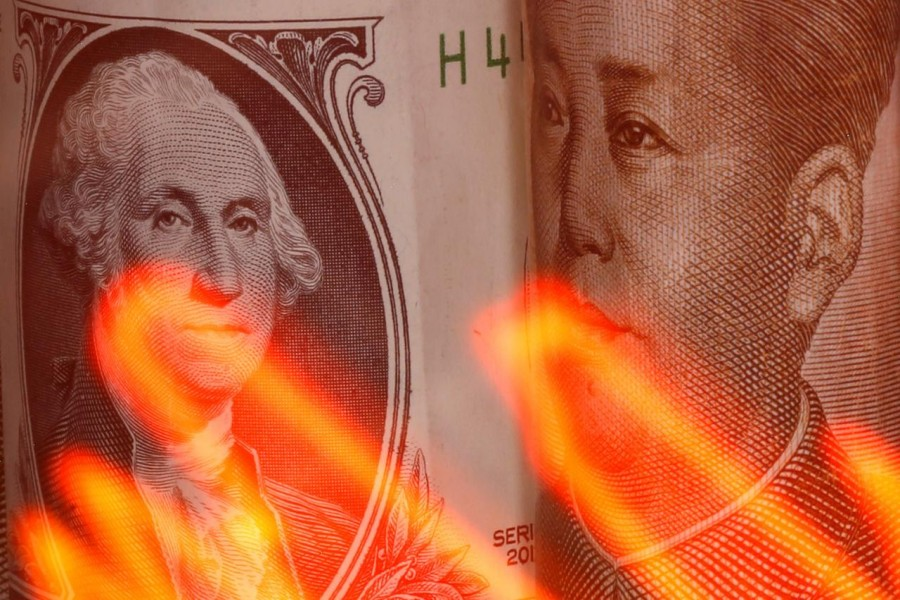 US dollar and Chinese Yuan banknotes are seen behind illuminated stock graph in this illustration taken on February 10, 2020 — Reuters/Files