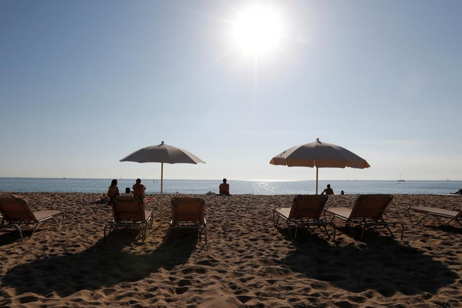 People sunbathe on a hot day in Barceloneta beach in Barcelona, Spain — Reuters file photo used only for representation