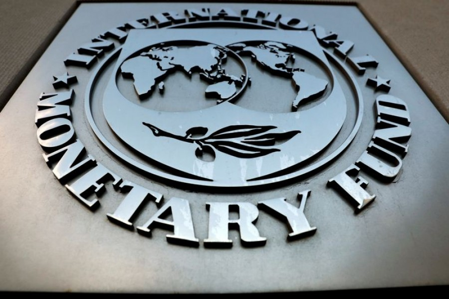 FILE PHOTO: The International Monetary Fund (IMF) logo is seen outside the headquarters building in Washington, US, September 4, 2018. REUTERS/Yuri Gripas