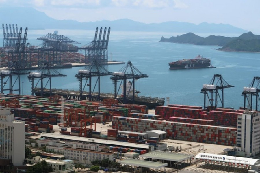 FILE PHOTO: A cargo ship carrying containers is seen near the Yantian port in Shenzhen, following the novel coronavirus disease (COVID-19) outbreak, Guangdong province, China May 17, 2020. Picture taken May 17, 2020. REUTERS