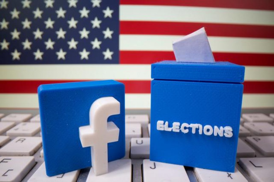 A 3D-printed elections box and Facebook logo are placed on a keyboard in front of US flag in this illustration taken October 6, 2020 — Reuters/Files