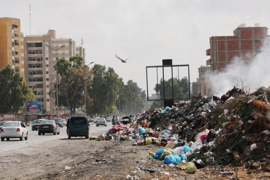 Cars pass next to the mounds of rubbish in Tripoli, Libya, October 12, 2019 — Reuters/Files