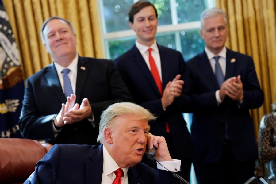 Secretary of State Mike Pompeo and White House senior advisor Jared Kushner applaud as US President Donald Trump is seen on the phone with leaders of Israel and Sudan speaking about the decision to rescind Sudan's designation as a state sponsor of terrorism, in the Oval Office at the White House in Washington, US, October 23, 2020. REUTERS/Carlos Barria
