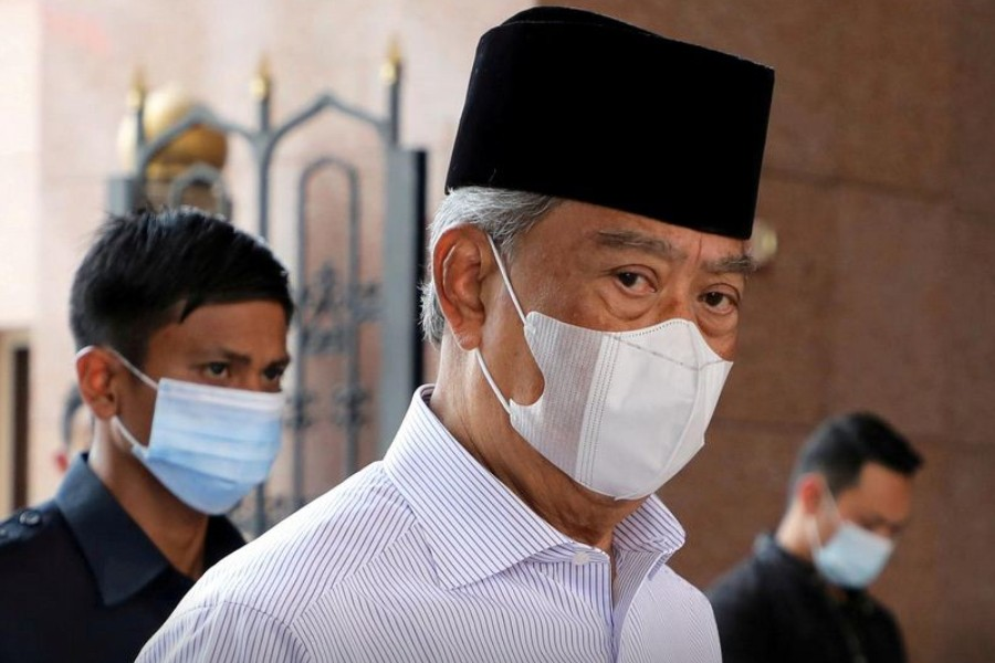 Malaysia's Prime Minister Muhyiddin Yassin wearing a protective mask arrives at a mosque for prayers, amid the coronavirus disease (COVID-19) outbreak in Putrajaya, Malaysia August 28, 2020. REUTERS/Lim Huey Teng/File Photo/File Photo