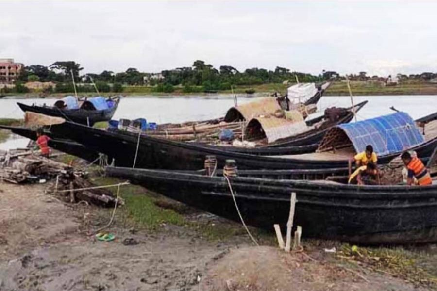 Fishermen have kept ready boats along with fishing equipment at Dublar Char in the Sundarbans to embark on their journey towards the deep sea for fishing. The picture was snapped on Sunday — FE Photo