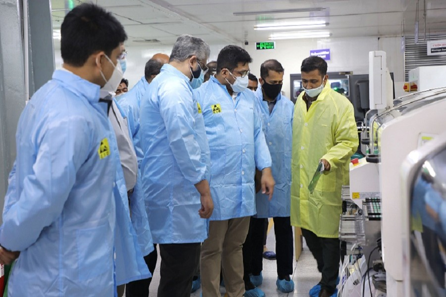 A team of nine teachers from Dhaka University's business faculty visits the Walton factory at Chandra in Gazipur on Saturday.