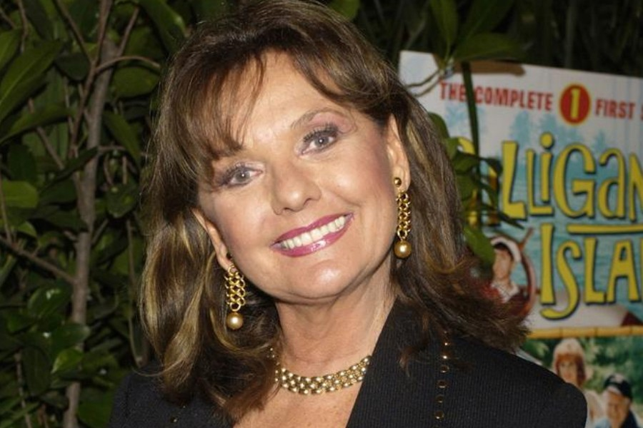 """Dawn Wells, who portrayed Mary Ann in """"Gilligan's Island,"""" poses during a launch party for """"Gilligan's Island: The Complete First Season,"""" in Marina Del Rey, California, February 3, 2004. REUTERS/Jim Ruymen/File Photo"""