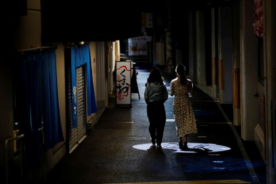 Women walk past a restaurant at a shopping district in Tokyo, amid the coronavirus disease (COVID-19) outbreak, Japan August 17, 2020. REUTERS/Kim Kyung-Hoon