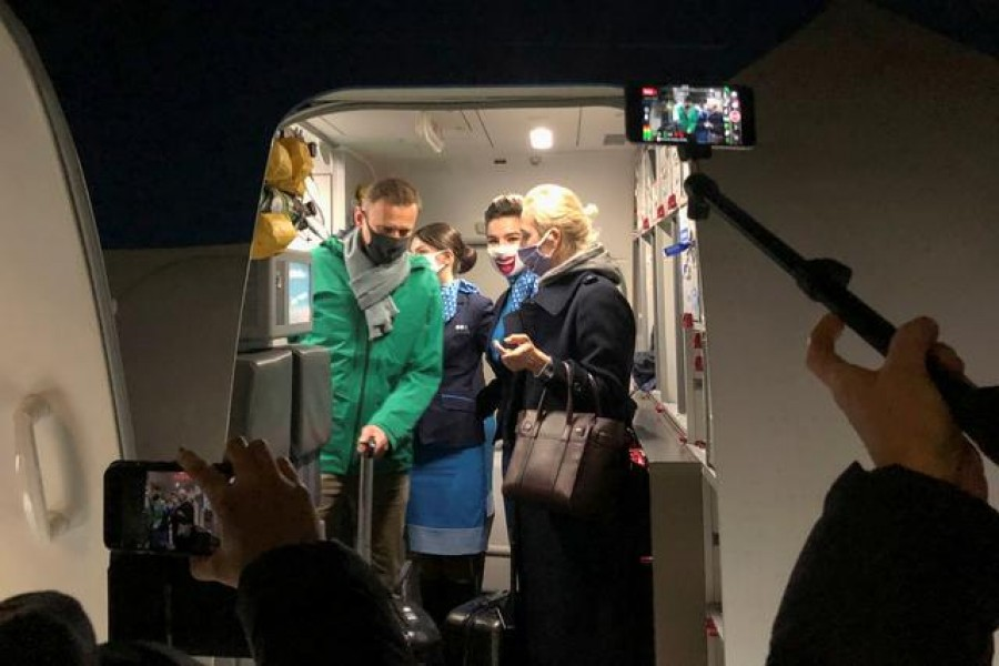 Russian opposition leader Alexei Navalny and his wife Yulia Navalnaya walk out of a plane after arriving at Sheremetyevo airport in Moscow, Russia, January 17, 2021— Reuters