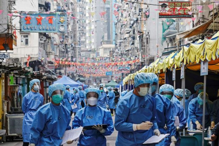 Health workers are seen in protective gear inside a locked down portion of the Jordan residential area to contain a new outbreak of the coronavirus disease (Covid-19), in Hong Kong, China on January 23, 2021 — Reuters photo