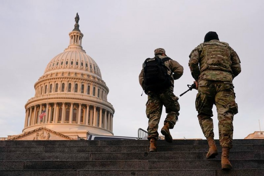 National Guard members walk at the Capitol, in Washington, US on January 15, 2021 — Reuters/Files