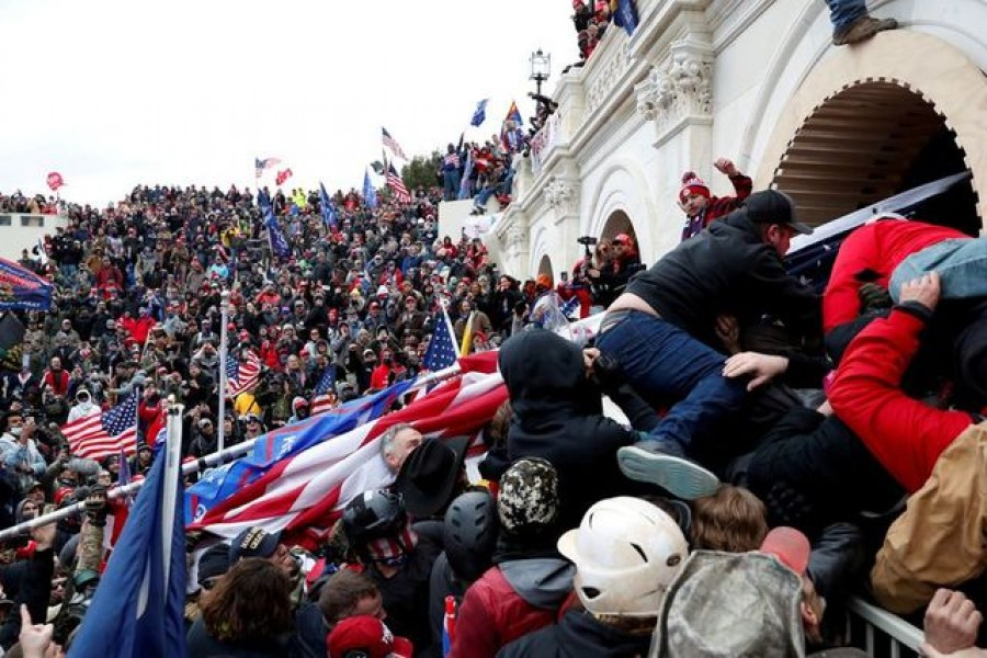 FILE PHOTO: Pro-Trump protesters storm into the US Capitol during clashes with police, during a rally to contest the certification of the 2020 US presidential election results by the US Congress, in Washington, US, January 6, 2021. REUTERS/Shannon Stapleton//File Photo