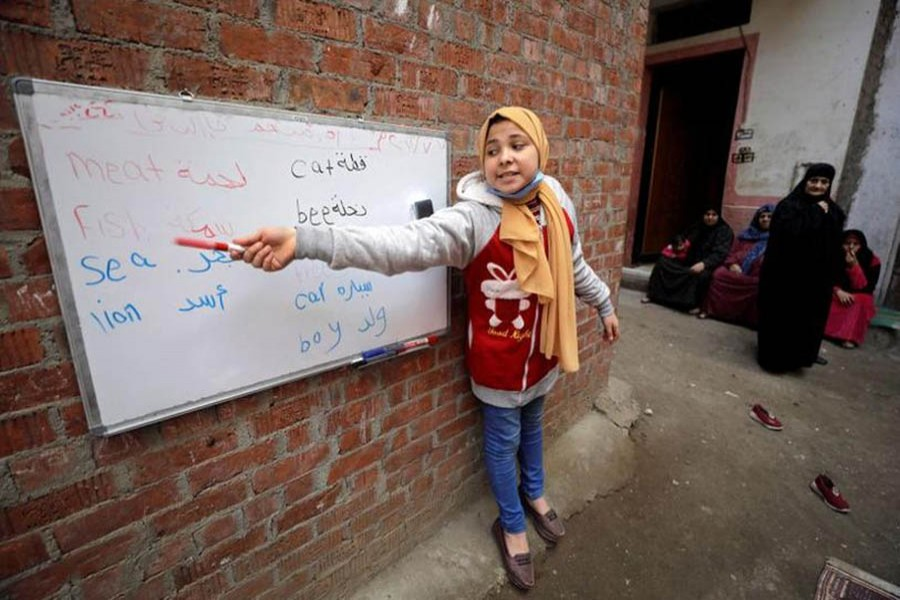 Reem El-Khouly, a 12-year-old girl, teaches children in Dakahlia province, Egypt