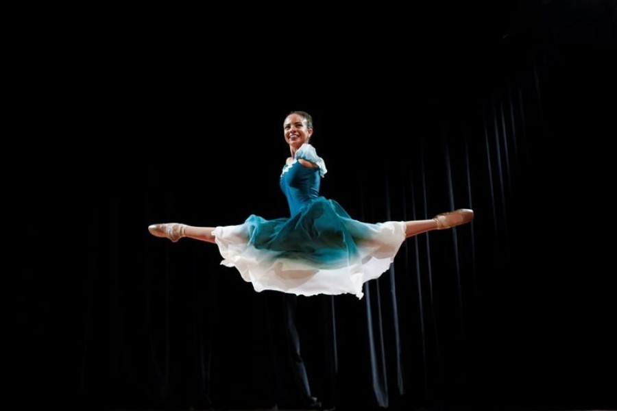 Vitoria Bueno, a 16-year-old dancer whose genetic condition left her without arms, jumps during a solo performance on stage at the Inatel Theater in Santa Rita do Sapucai, Brazil on February 5, 2021 — Reuters/Files
