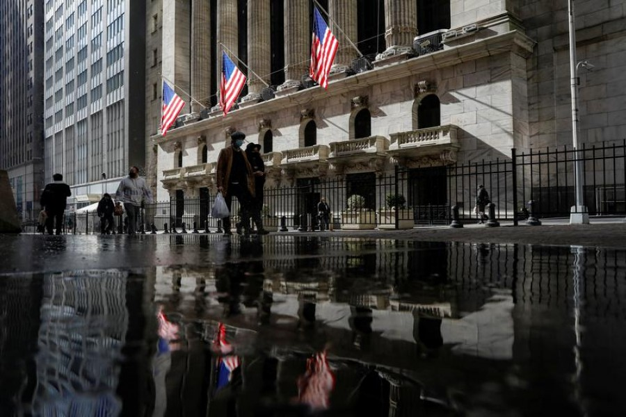 US flags fly out in front of the New York Stock Exchange (NYSE) is seen in New York, US, February 16, 2021. REUTERS/Brendan McDermid