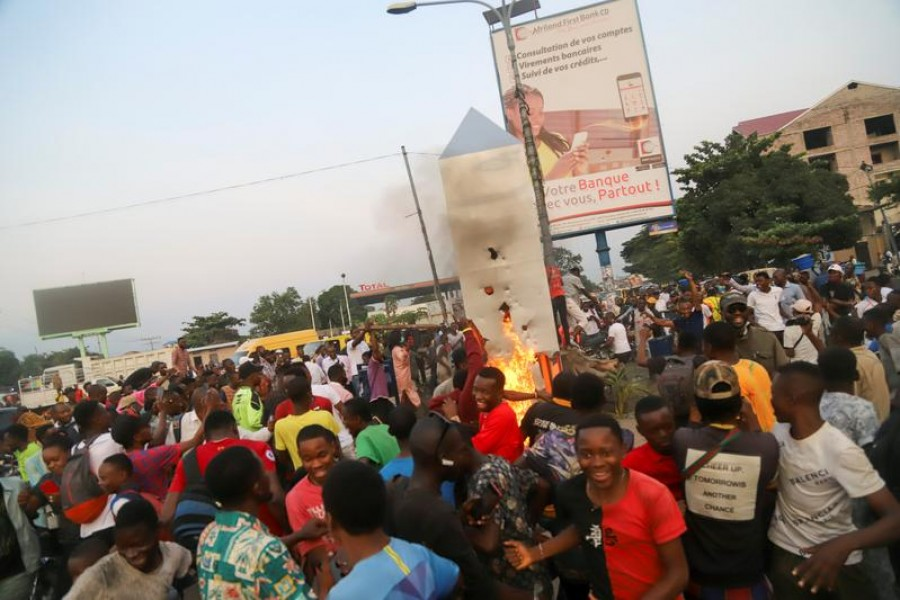 Residents set fire to the mysterious monolith that appeared in Kinshasa, Democratic Republic of Congo February 17, 2021 — Reuters