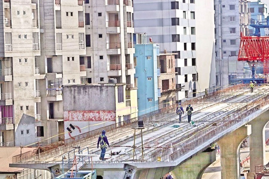 Metro rail line between Dhaka's Uttara and Agargaon visible