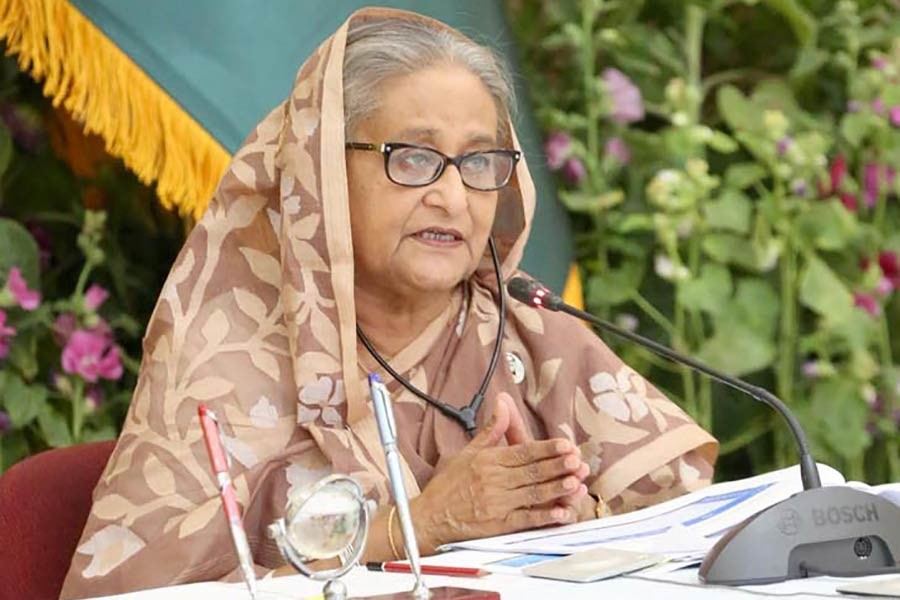 Prime Minister Sheikh Hasina presiding over the National Economic Council (NEC) meeting held at the NEC conference room through a videoconference from Ganabhaban on Tuesday -PID Photo