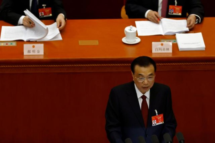 Chinese Premier Li Keqiang speaks at the opening session of the National People's Congress (NPC) at the Great Hall of the People in Beijing, China March 5, 2021. REUTERS/Carlos Garcia Rawlins