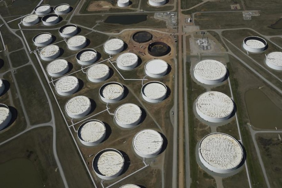 FILE PHOTO: Crude oil storage tanks are seen from above at the Cushing oil hub, in Cushing, Oklahoma, March 24, 2016. REUTERS/Nick Oxford/File Photo