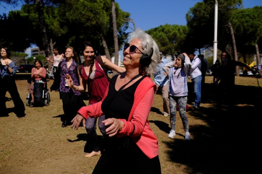 Barcelona residents use their headphones while listening to music as they dance during a socially-distant silent disco event on the first Spring weekend at Mar Bella beach in Barcelona, Spain on March 21, 2021 — Reuters/Files