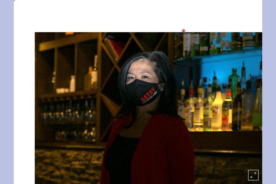 Owner Jan-le Low poses for a portrait at Satay Thai Bistro and Bar, amid the coronavirus disease (COVID-19) outbreak, in Las Vegas, Nevada, U.S., March 28, 2021. Picture taken March 28, 2021. REUTERS/Bridget Bennett