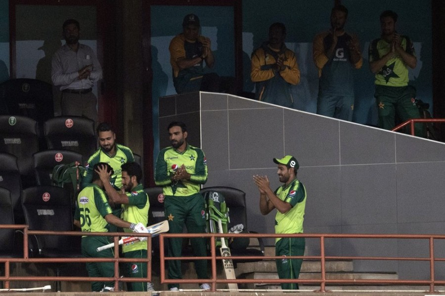 Pakistan's captain Babar Azam, left, celebrates with teammates after his dismissal for 122 runs during the fourth T20 cricket match between South Africa and Pakistan at Centurion Park in Pretoria, South Africa, Wednesday, on April 14, 2021 — AP photo