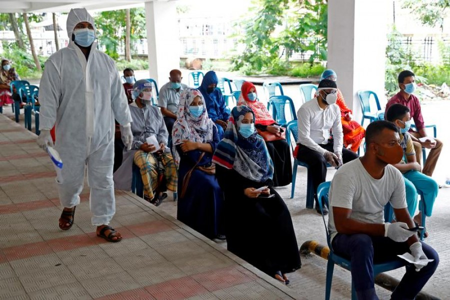 People sit as they come to a coronavirus testing centre in the Mugda Medical College and Hospital as the coronavirus disease (Covid-19) outbreak continues in Dhaka, Bangladesh, July 2, 2020 — Reuters/Files