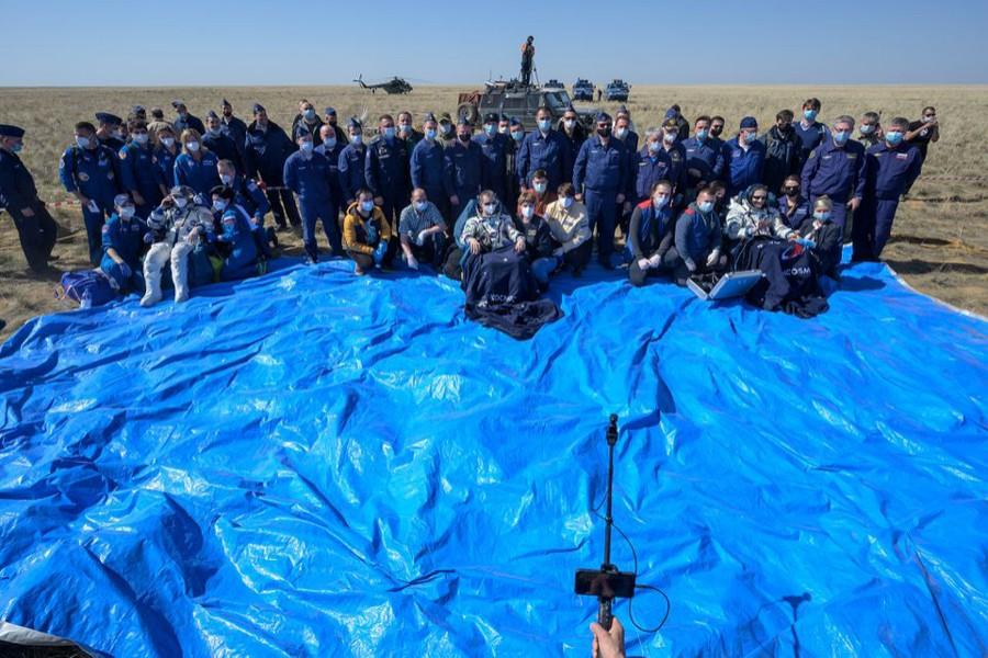 The International Space Station (ISS) crew members Kathleen Rubins of NASA, Sergey Ryzhikov and Sergey Kud-Sverchkov of Roscosmos pose for a picture after landing with the Soyuz MS-17 space capsule in a remote area outside Zhezkazgan, Kazakhstan on April 17, 2021 — NASA handout via REUTERS