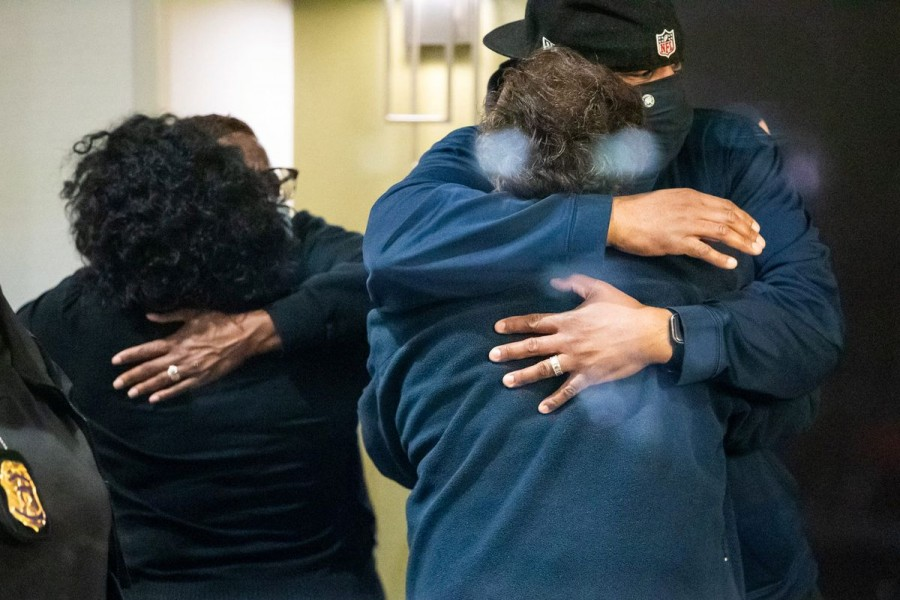 People embrace after learning that their loved one was safe after a mass casualty shooting at the FedEx facility in Indianapolis, Indiana, US, April 16, 2021. Mykal McEldowney/IndyStar/USA Today Network via REUTERS.