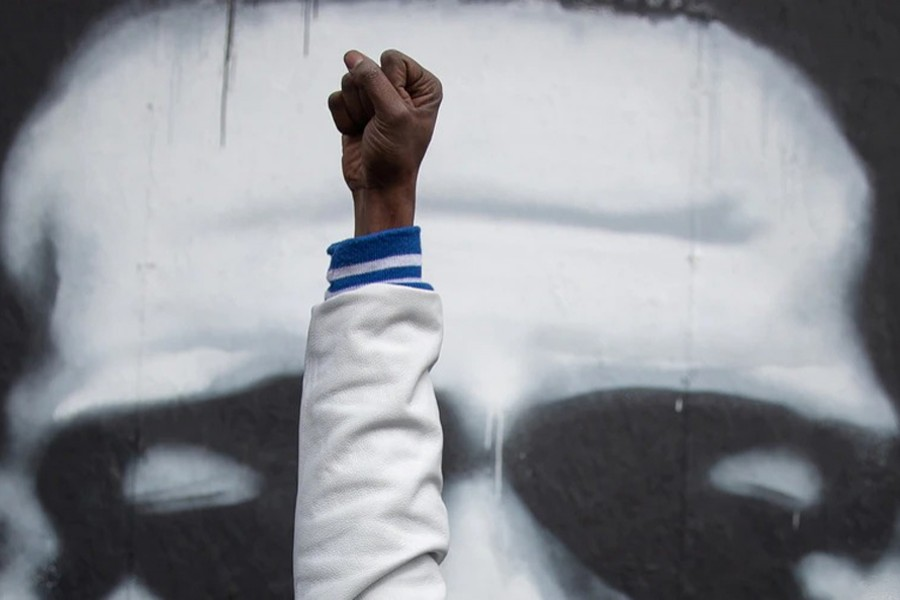 A Local resident raises his fist in front of an image of George Floyd after the verdict in the trial of former Minneapolis police officer Derek Chauvin, at George Floyd Square in Minneapolis, Minnesota on April 20, 2021 — Reuters photo