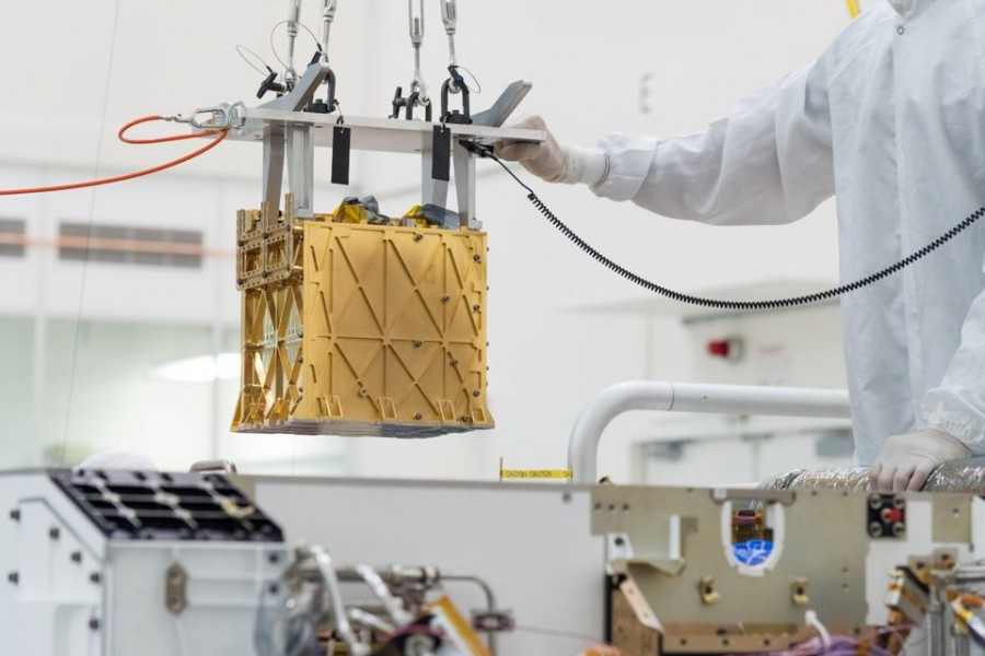 Technicians at NASA's Jet Propulsion Laboratory lower the Mars Oxygen In-Situ Resource Utilization Experiment (MOXIE) instrument into the belly of the Perseverance rover in an undated photograph in Pasadena, California, US NASA/JPL-Caltech/Handout via REUTERS