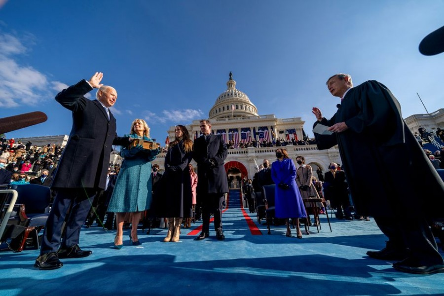 Joe Biden is sworn in as the 46th president of the United States by Chief Justice John Roberts as Jill Biden holds the Bible during the 59th Presidential Inauguration at the US Capitol, in Washington, US, January 20, 2021. Andrew Harnik/Pool via REUTERS/File Photo