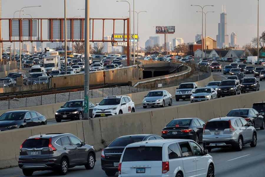 Travelers are stuck in a traffic jam as people hit the road before the busy Thanksgiving Day weekend in US in 2017 -Reuters file photo
