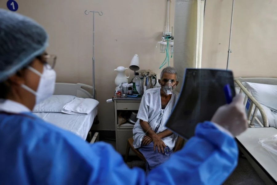 A doctor checks an X-ray of a patient suffering from the coronavirus disease (Covid-19) inside a Covid-19 ward of a hospital in New Delhi, India on May 1, 2021 — Reuters photo